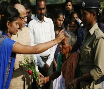 A senior citizen being welcomed