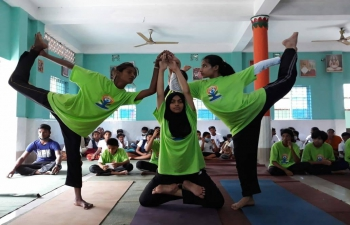 Another #YogaForWellness event was organized on the occasion of #IDY2021 by Naljhuri Sri Sri Nigamananda Saraswat Ashram, Mirbag, Kaunia, Rangpur on June 19, 2021 to highlight the immense potential of Yoga in enhancing the physical, psychological and emotional aspects of our well-being.  Assistant High Commissioner of India in Rajshahi, Shri Sanjeev Kumar Bhati congratulated the Executive Chairman of the Ashram Committee, Mr. Mrinal Kanti Roy and his team for their efforts in promoting Yoga as a system of holistic living.